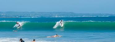 Surfing at Kuta Beach, Bali